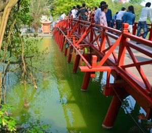 Tourists on the Red Bridge over Lake Hoan Kiem in central Hanoi Vietnam.