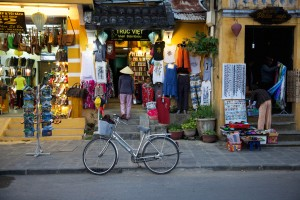 Woman in traditional conical hat on the market street of Hoi An