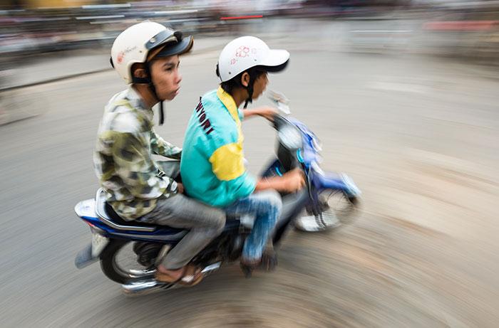 bigstock-Two-Men-On-Bike-In-Hoi-An-Vie-65189665_web